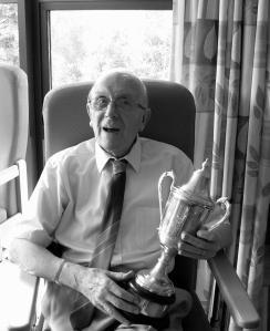 Celebrating: Ron Davies pictured with the Welsh League Division Two trophy in 2011.