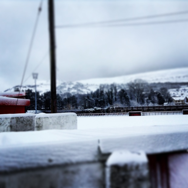 The playing surface at Ynys Park is covered in at least 20cm of snow.