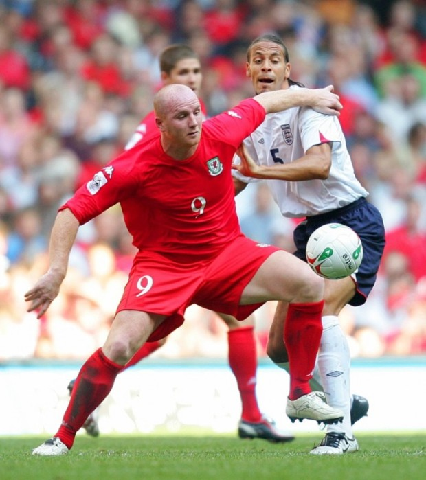 Hartson in action for Wales against England