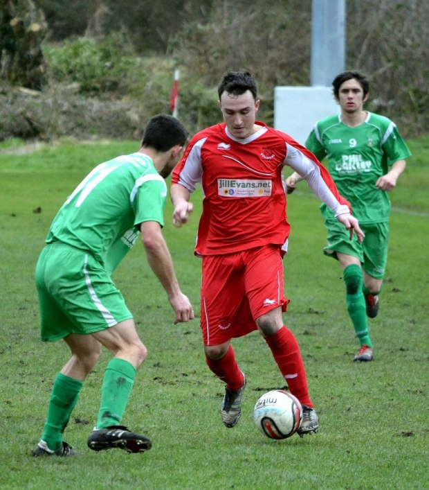 Action: Josh Powell passes a Caerleon challenger in midfield.