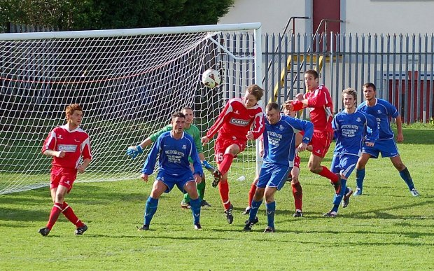 Bulldogs midfielder Josh Evans has a chance to score with a header in a previous encounter between West End and Ton Pentre at Pri Deri Park.