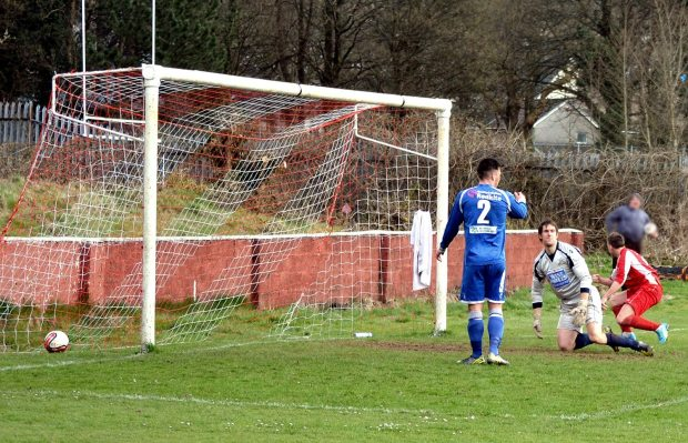 Wearn scores the equalising goal following a long throw-in from Toghill.