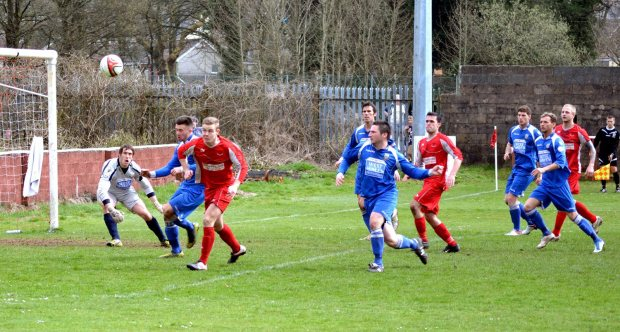 Joe Leady has a headed attempt at goal for Ton Pentre against Haverfordwest County.