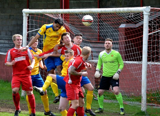 Action from last season's encounter between Ton Pentre and Monmouth Town at Ynys Park.