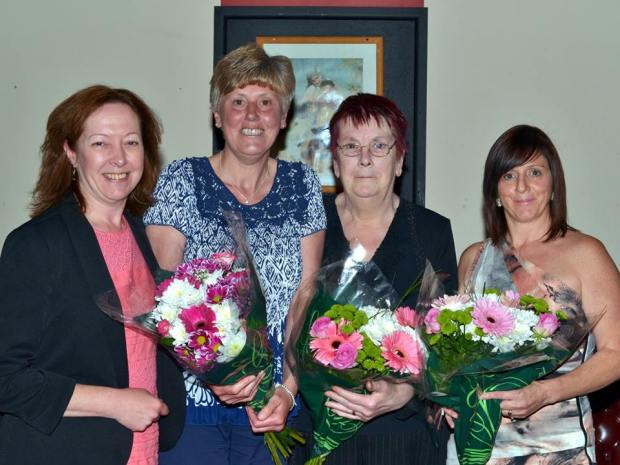 Jill Evans presents flowers to Gaynor Dowling, Marilyn James and Michelle Hardy.