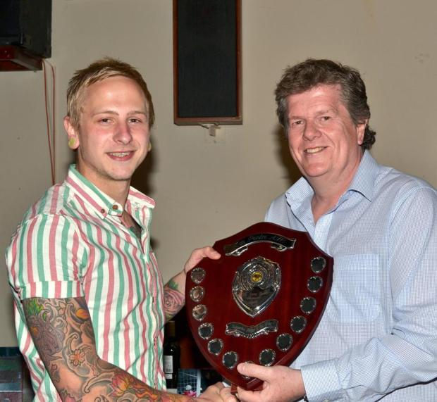 Thomas Davies receives the Kenny Bowen Memorial Shield Supporters Player of the Year award from John Bowen.