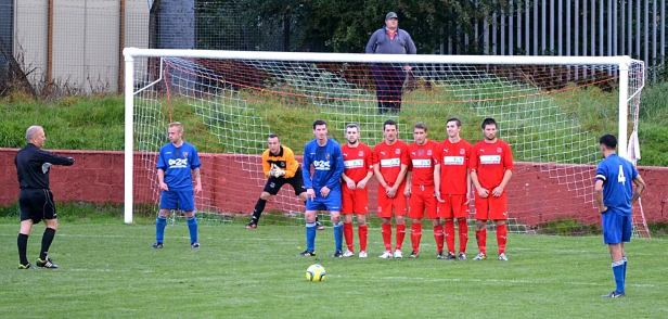 Yeates prepares to take a free kick for Fairfield United.