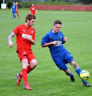 Leon Young gets set to challenge for the ball from a Fairfield United player.