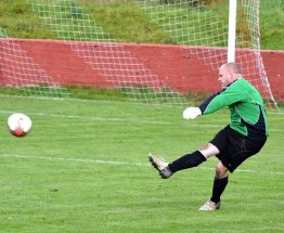 Randell boots the ball up the pitch for Fairfield United.