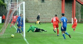 Craig Reddy runs away celebrating after scoring Ton Pentre's third goal.
