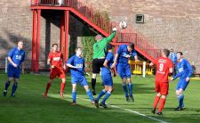 Randell punches the ball away following a Ton Pentre attack.