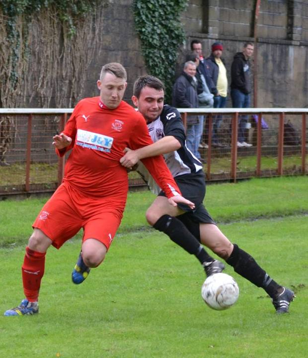 Ton Pentre striker Jaymie Wearn attempts to get around a Sully Sports defender.