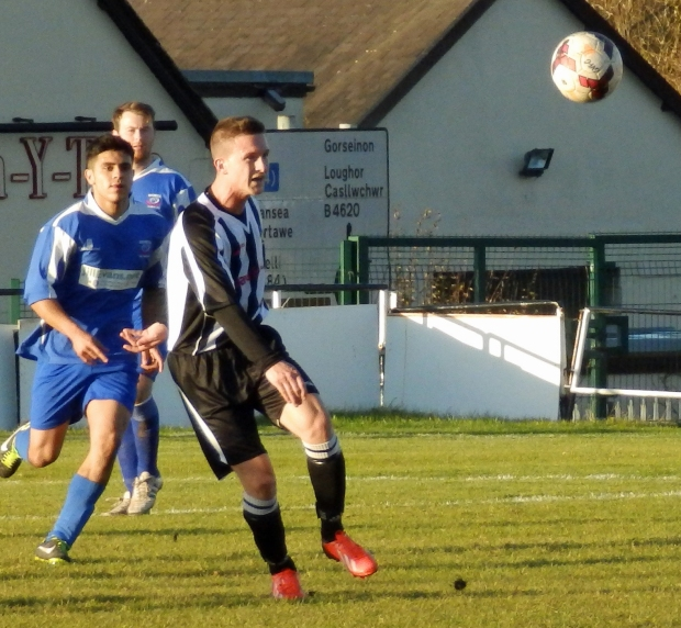 Garden Village and Ton Pentre battle for the ball.
