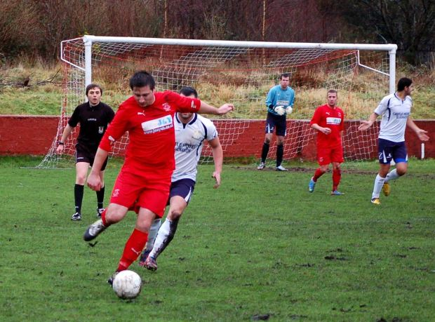 Ton Pentre midfielder Adam Raymond with the ball.