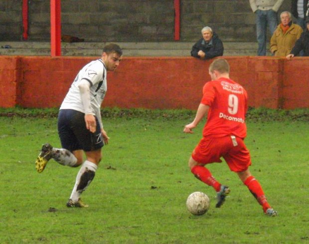 Bulldogs striker Dorian Sweet runs at a Cwmbran Celtic defender.