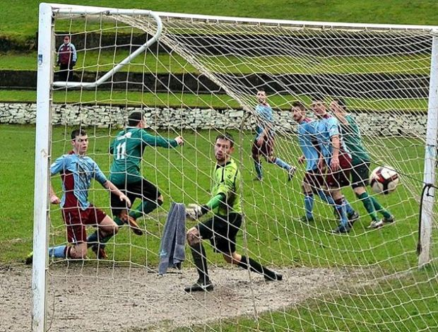 Jaymie Wearn gives Ton Pentre the lead in the Rhondda Derby match at AFC Porth.