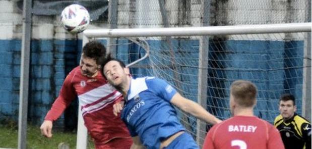 Marck Crutch (left) defends against Port Talbot Town.