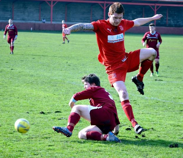 Ton Pentre's Leon Young is dispossessed by a Tata Steel defender.