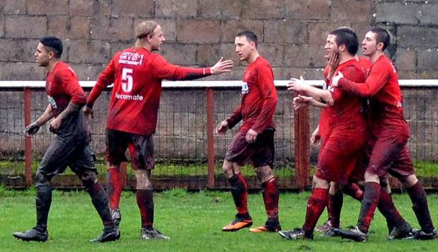 Jaymie Wearn celebrates his goal and the players congratulate Adam Raymond for his excellent assist.