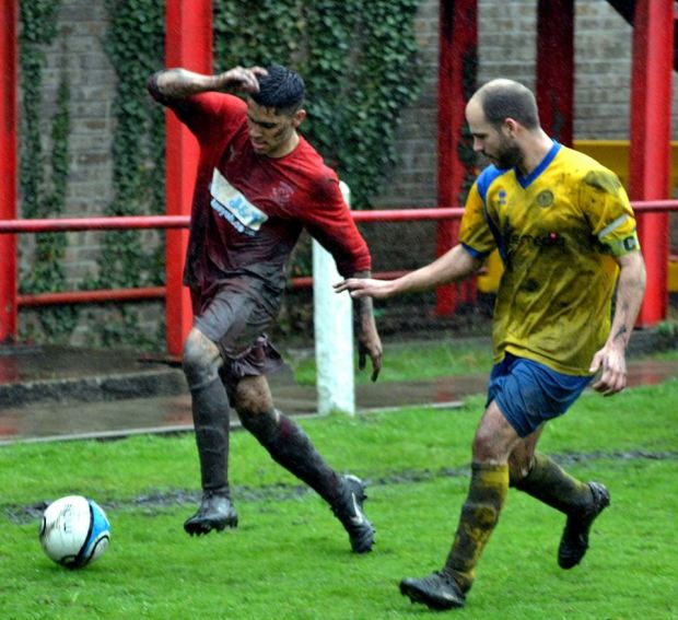 Andre Griffiths, who had an excellent game, runs down the wing with the ball.
