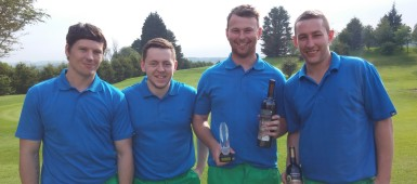 Ross Porter holds the Ton Pentre AFC Golf Day trophy alongside with his fellow team mates.