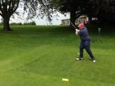Swinging action.