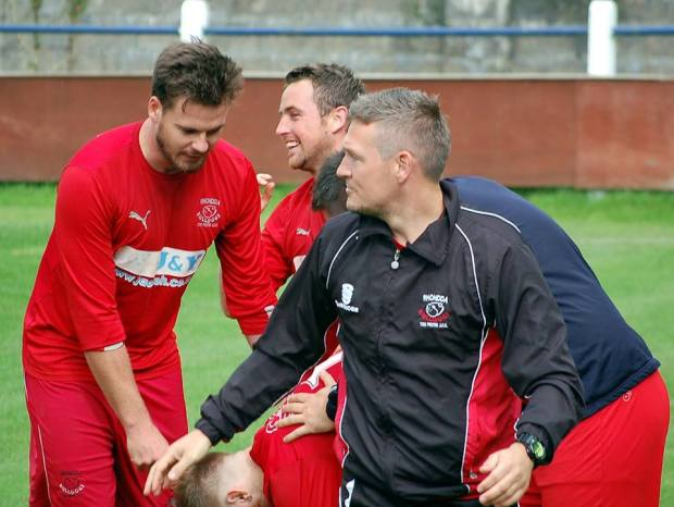 Dan Richards, Ryan Jenkins and Assistant Manager Andrew Hughes celebrate with Shane Davies following his goal.