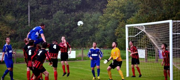 Mark Crutch jumps to head the ball above the Goytre defence.