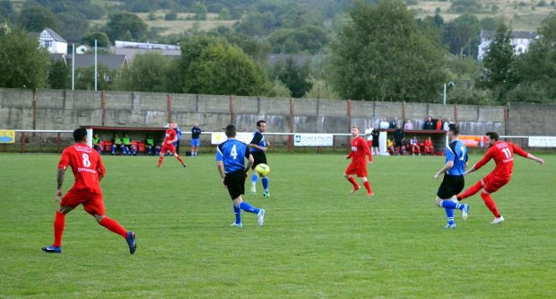 Dan Richards takes a long range shot against Penybont.