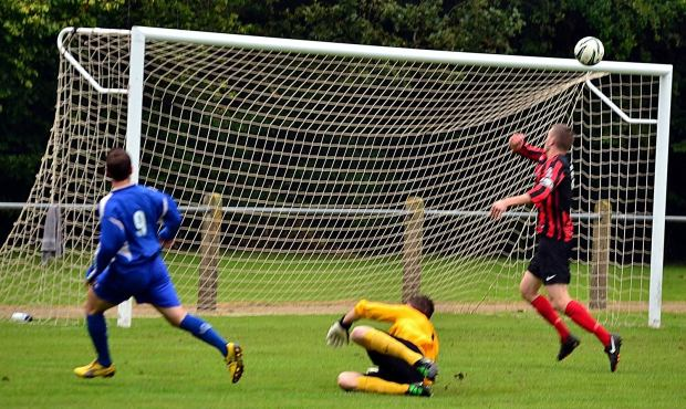With the goalkeeper completely beaten, Ryan Jenkins came incredibly close to scoring for Ton Pentre.