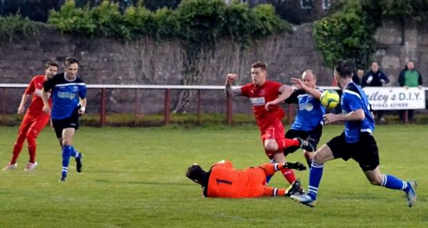 Leon Young is put in on goal but Penybont goalkeeper Chris Curtis makes the save.