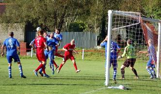 Haverfordwest County are forced to defend a Ton Pentre corner.