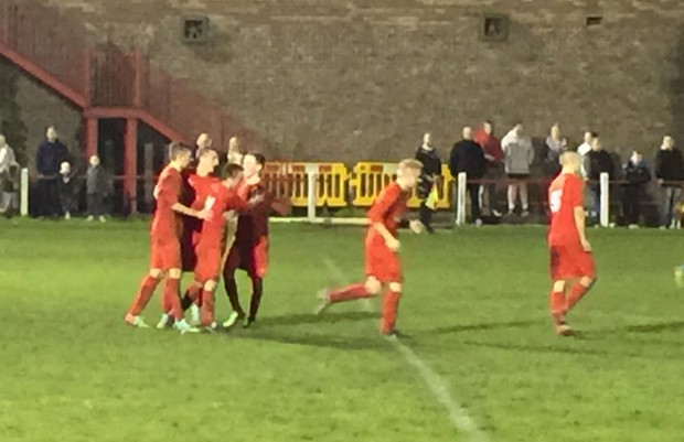 The team celebrates following Emms goal.