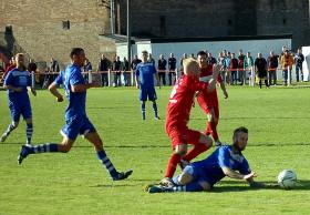 Ryan Morgan is tackled by a Haverfordwest County defender.
