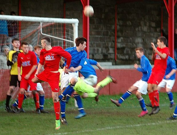 Connor Berry heads Ton Pentre level in the 90+5' minute.