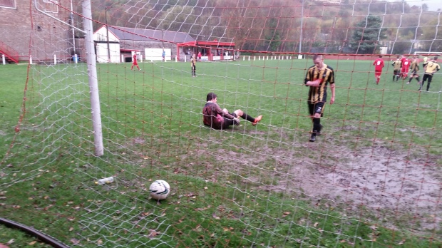 The ball ends up in the back of the net for Ton Pentre's sixth goal of the match.