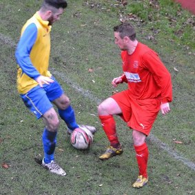 Ryan Jenkins, who had an impressive game for Ton Pentre against Afan Lido, looks to retrieve possession from an opponent.