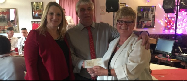 Shelley Rees-Owen and Maureen Weaver present a cheque to Bulldogs Secretary Rhys Williams.