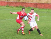 Ton Pentre's Sam Small and Aberbargoed's Darcy Blake challenge for the ball.