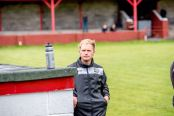 Lee Williams pictured in the away dugout at Ynys Park earlier this season.