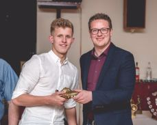 Kieran Tann receives the Youth Team Top Goalscorer trophy from Rob Dowling.