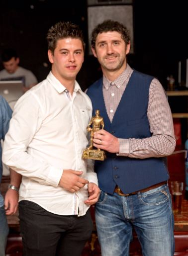 Ton Pentre manager Lee Phillips presents Leon Jacka with the Manager's Player of the Year trophy.