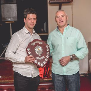 Leon Jacka is pictured with Head of Football Development Graham Bassett, presenting the Bulldogs midfielder with the Kenny Bowen Supporters Player of the Year Memorial Shield.
