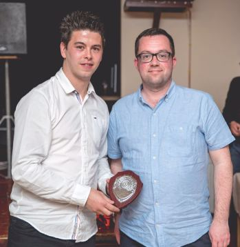Matthew Green from the 1896BULLDOGS supporters group presents Leon Jacka with his award for being voted Supporters Player of the Year.