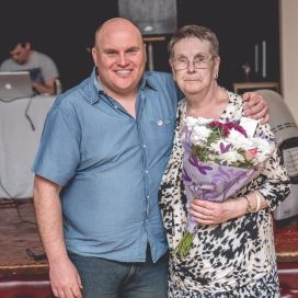 Bulldogs Chairman Ceri Jones is pictured with Marilyn James, who received a bouquet for her work in the matchday canteen.