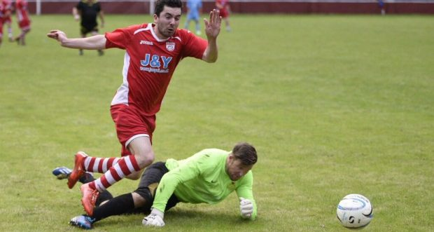 Lewis Hitchock is brought down in the box against Llantwit Fardre.