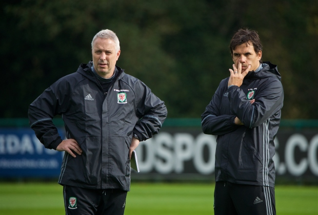 Kit Symons and Chris Coleman look on in a Wales training session.